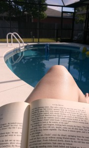 This was me every morning, reading Lord of the Rings poolside.